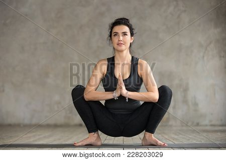 Young Sporty Woman Practicing Yoga, Doing Garland Exercise, Malasana Pose, Working Out, Wearing Spor