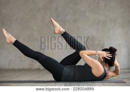 Young Slim Woman Practicing Fitness, Doing Crisscross Exercise, Bicycle Crunches Pose, Working Out,