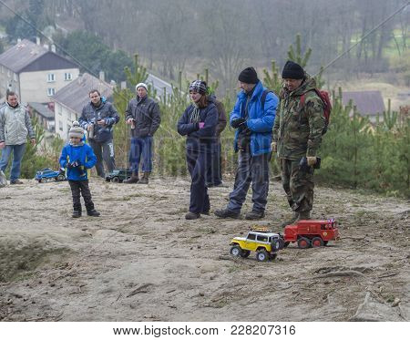 Czech Republic, Zelizy, February 10, 2018: Group Of German People Men Woman And Little Boy Driving O