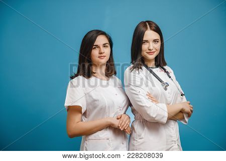 Group Girl Young Doctor Student Stethoscope, White Robe, Surgical Pants. Concept Medicine, Intern, C