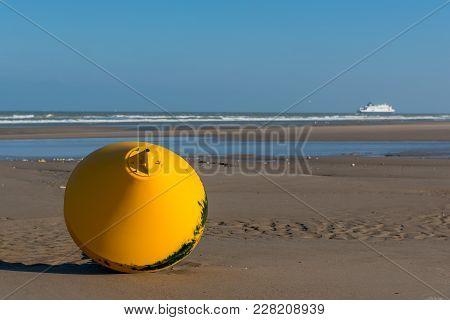 Buoy On The Beach