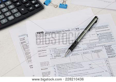 Us Tax Form 1040 With Pen And Calculator
