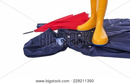 Raincoat And Umbrella And Rubber Boots On A White Background. Still Life.