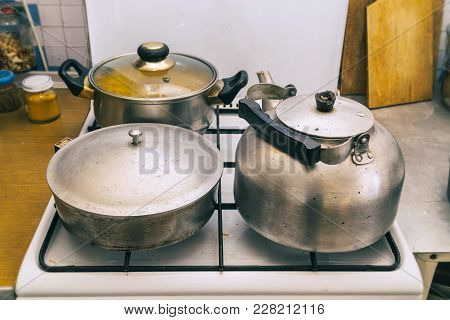 Pan, Frying Pan And Kettle On The Stove In The Kitchen