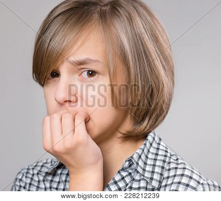 Close-up Emotional Portrait Of Caucasian Girl Hand Covering Her Mouth Feels Fright Shock On A Gray B