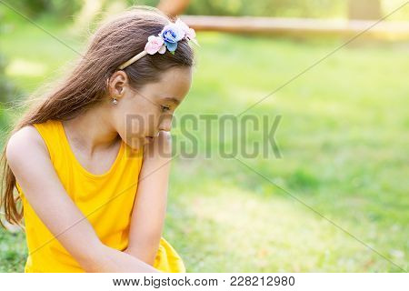 Portrait  Of A Sad Beautiful Teen Girl Dreaming Outdoors.  Place For Text