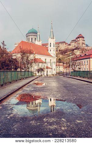 Saint Ignatius Church And Monumental Basilica With Reflection In Rain Water, Esztergom, Hungary. Tra