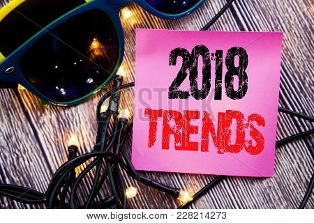 Hand Writing Text Caption Showing 2018 Trends. Business Concept For Trending Data Prediction Written