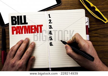Word, Writing Bill Payment. Business Concept For Billing Pay Costs Written Book, Wooden Background W