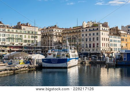 Marseille, France - December 4, 2016: The Historic Harbor Old Vieux Port And The Ferry Boat In Cente