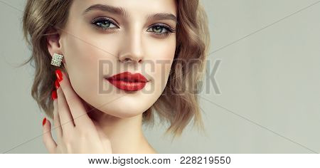 Beautiful Model Girl With Short Curly  Hair And Red Lips . Red Manicure On Nails .beauty And Estheti