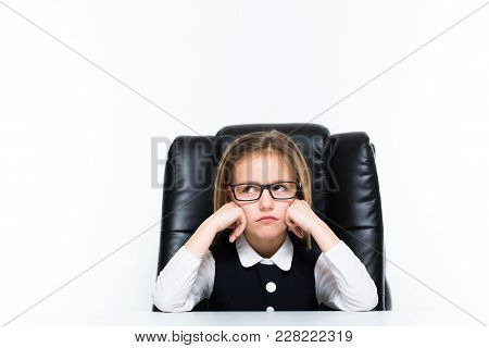 Adorable Cute Angry Little Girl Sitting In Chair In Office Dressed As A Businesswoman On White Backg