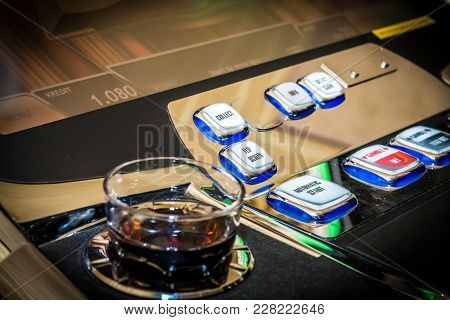 Gambling Concept. Glass With Alcohol And Slot Machine Buttons, Game Bet, Collect, Flip Screen, Autom