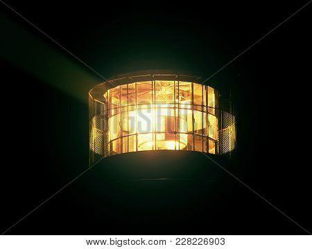Detail Of Turning Lamp In Lighthouse. Detail Of Fresnel Lens. Tower Illuminated With Strong Warning