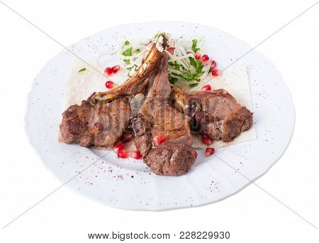 Delicious Lamb Racks On Pita With Onions And Pomegranate Seeds. Isolated On A White Background.