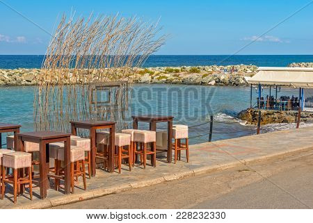 Tables And Chairs Of Street Cafe On Seafront