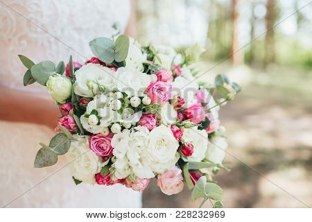 Wedding Bouquet Of Roses In The Hands Of The Bride.