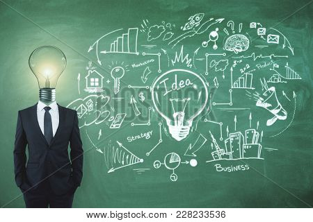 Lamp Headed Businessman On Chalkboard Background With Business Sketch. Idea, Solution And Finance Co