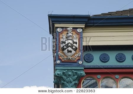 The Coat of Arms of Huddersfield Yorkshire on the ornate cast iron facade of a market hall poster