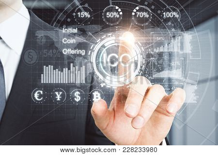 Cryptocurrency, Cryptography And Ico Concept. Businessman Hand With Abstract Digital Hologram On Blu