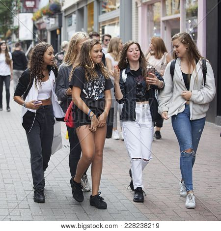 London, England - August 11 2017 A Young Teenagers Girls Walks Along Carnaby Street. Carnaby Street