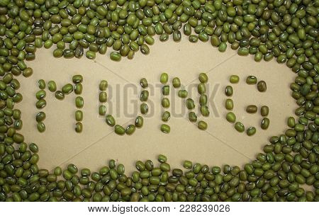 Mung Inscription By Mung Beans. Dry Mung Foof Ingredient Concept.