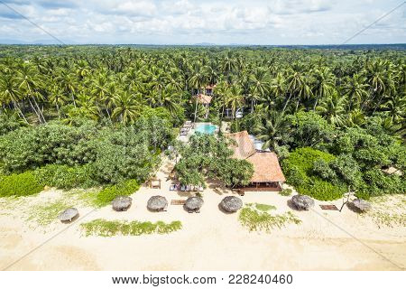Aerial View Of The Tropical Beach With A Lonely Hotel In Sri Lanka. Resort Beach In The Sunlight. Be