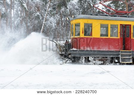 Railroad Snow Removal Equipment During A Snowstorm. Cleaning Of Tram Tracks In Winter, Moscow, Russi