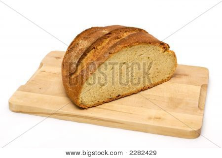 Bread Loaf On Wooden Cutting Board