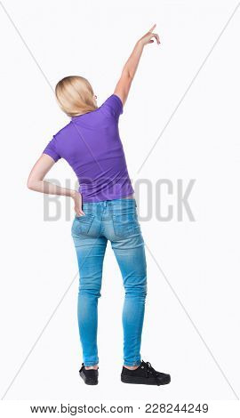 Back view of  pointing woman. beautiful girl. Rear view people collection.  backside view of person.  Isolated over white background. Long-haired blonde in the purple shirt is pointing upwards.