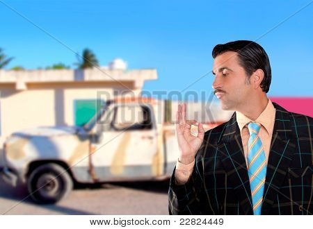 car used salesperson selling old car as brand new  typical topic salesman with hand ok gesture [Photo Illustration]