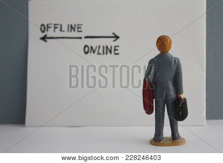 Miniature Man In Grey Coat Back View. Thinking About Online And Offline Options. Business Marketing