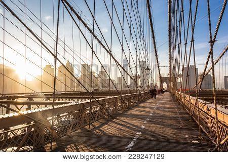 People Walking On Pedestrian Path Across Brooklyn Bridge. New York City Manhattan Downtown Skyline I