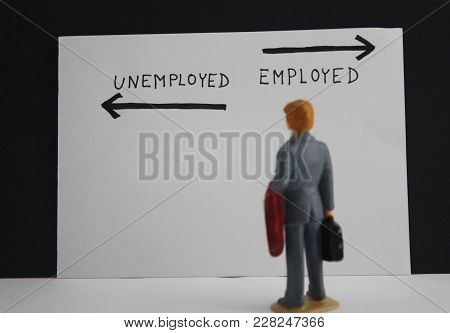 Businessman Miniature Person Stands Before The Inscriptions Unemployed And Emploýed With Arrows. Job