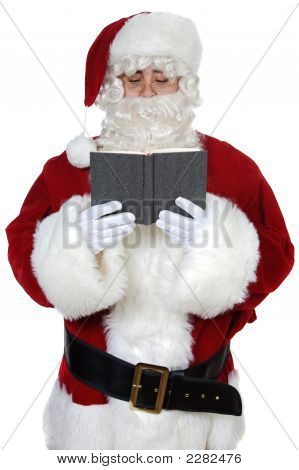 Santa Claus Reading A Book