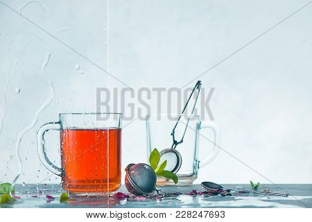 Cup Of Tea And Cup With Tea Strainer, Transparent On A Light Background With Green Leaves. Spring St
