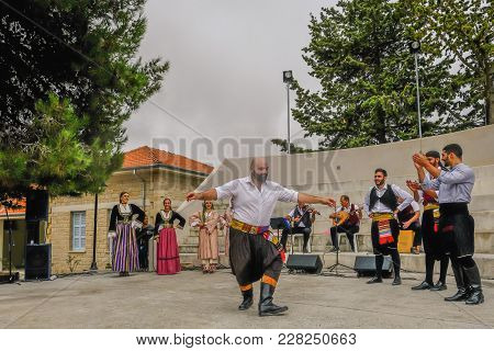Arsos, Cyprus - October 8, 2017:  Cypriot Dancer Performing In Traditional Costumes With Other Dance