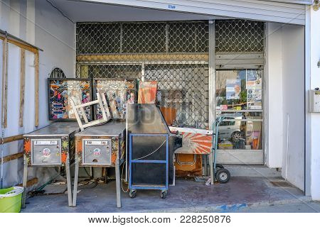 Limassol, Cyprus - October 1, 2017: Old Pinball Machines Piled Up Outside A Shop.