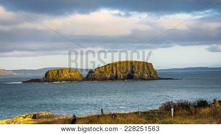 Ballintoy, Republic Of Ireland, Uk - 28/12/2016 : A Couple Of Tourist Photographing The Sheep Island
