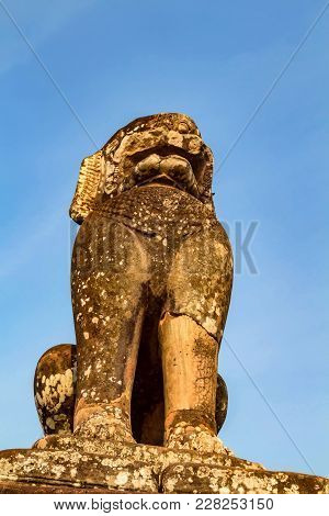 Stone Singha Lion Statue Protecting Cambodian Temple