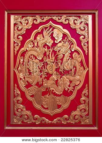 Golden Chinese Dragon In Red Wall