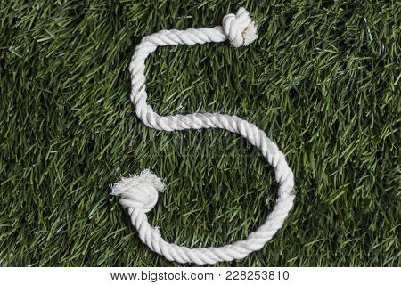 Rope Numbers On Grass Background. Number 5. Five