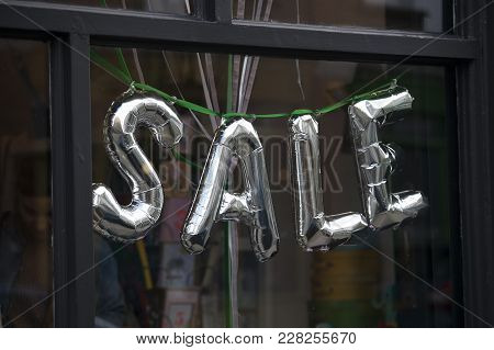 Inflated Silver Sale Sign In The Store Window