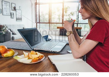 Woman Working With Laptop Eating Breakfast Drinking Coffee.