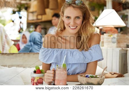 Pretty Young Woman In Sylish Blouse, Drinks Shake, Eats Salad, Sits At Cafeteria, Smiles Happily, Sp