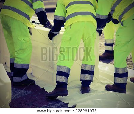 Civil Protection Men With High Visibility Clothing To Prevent Flooding