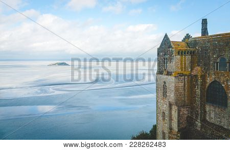 Scenic View On Small Tombelaine Tidal Island And Fragment Of Abbey On Le Mont Saint-michel Island Fa