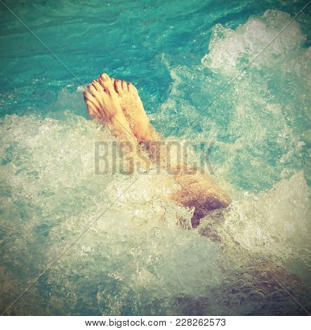 Woman In Spa Pool And Whirlpool At Her Feet With Vintage Effect