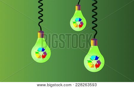 Hanging On Cords Three Light Bulbs On A Green Background, On Them There Is Rainbow Recycling, Recycl