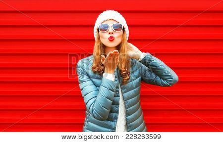 Fashion Woman Blowing Red Lips Sends An Air Kiss On A Background